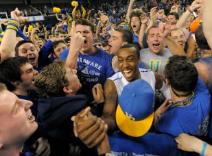Delaware #4 Jarvis Threatt celebrates with fans after winning the CAA Men's 2014 Basketball Tournament